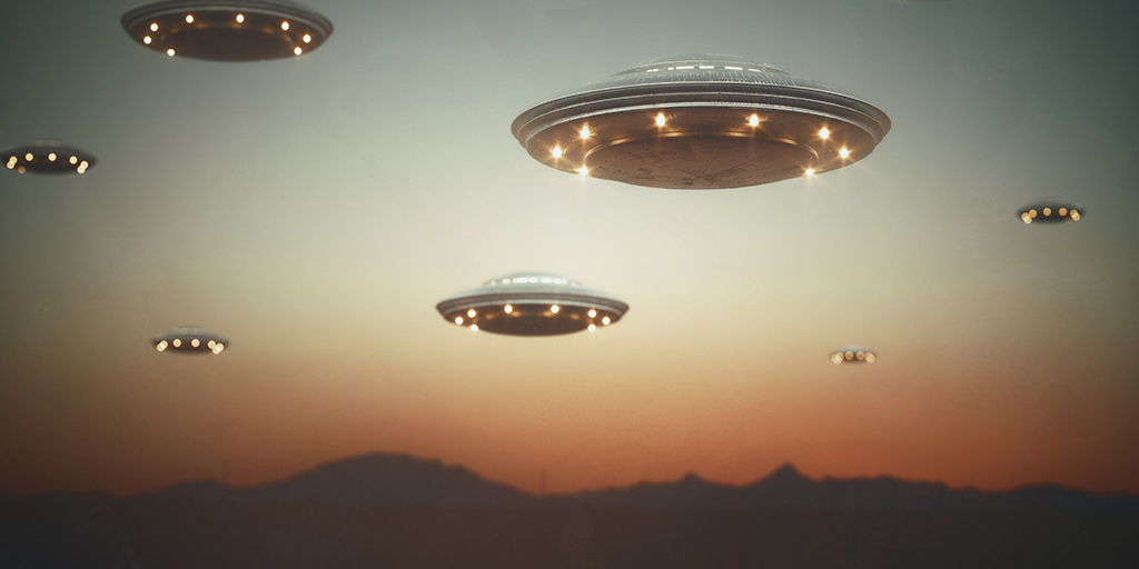 ufos flying over a desert landscape